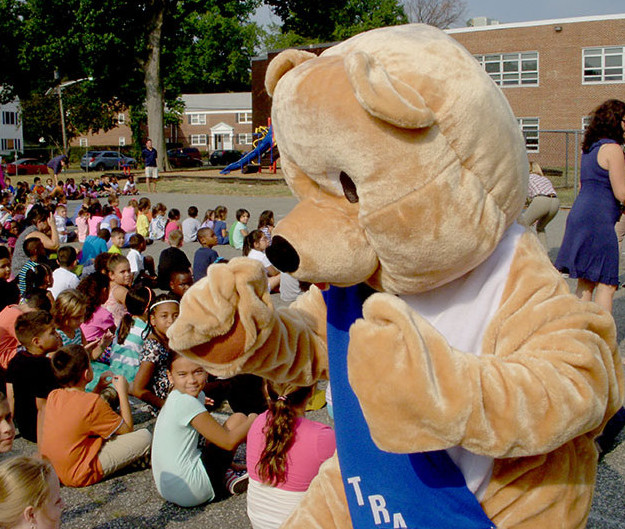 (above)  Tracker the Bear Welcoming everyone Back to School.