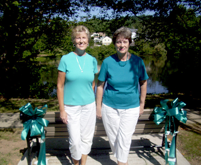 (above l-r) Lynn Stahl and Lynn Franklin of Watchung, volunteers for Kaleidoscope of Hope Ovarian Cancer Foundation with newly dedicated bench at Watchung Lake.