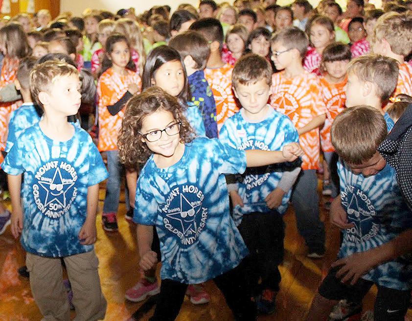 "(above) Grace DiNardi dances ""The Twist"" with her kindergarten classmates as they celebrate Mt. Horeb School's golden anniversary."