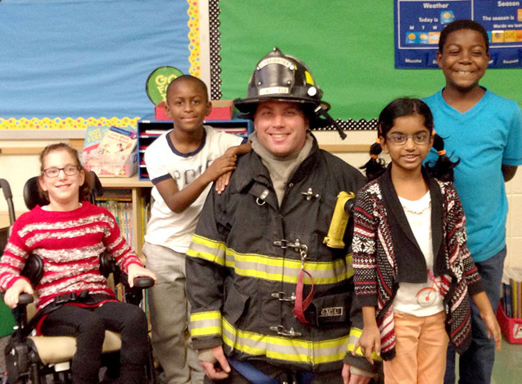 (above) Bayberry School students in Mrs. Colleen Owens' class were visited by firefighter Neil Owens, Mrs. Owens' husband, who gave a lesson in fire prevention.