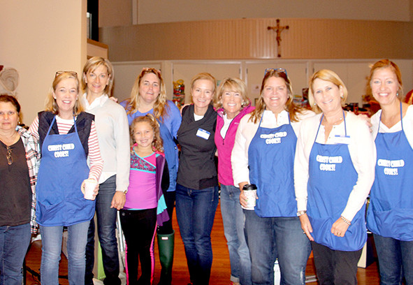 Christ Child Members and Friends Prepare to Open The Doors at 7th Annual Rummage Sale (above l-r) Marilyn Chambeau, Marge Yobbi, Margaret Strong, Kathi Franolich, Paddie Donohue, Paddie's granddaughter Maeve, Lori White, Marjorie Waltinger, Jill Stanley, Lambi Newsham, Kathryn Colao