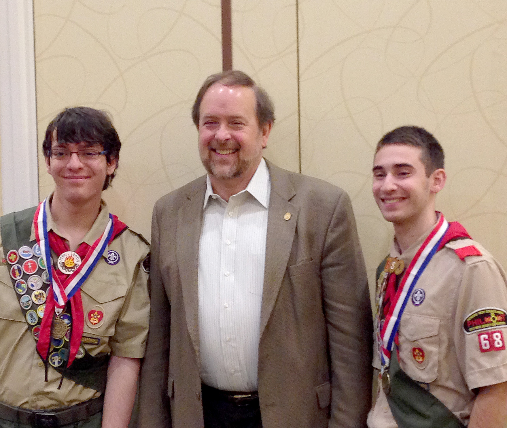 (above l-r) flanking Troop 68 Scoutmaster Cliff Boldt) Colin Hegarty and Nick Young received BSA Scholar Athlete Awards at a recognition breakfast on December 20. The award is given by Patriots Path Council of BSA to over 50 Scouts from central New Jersey troops who have excelled in the classroom and on the athletic field while also being successful Boy Scouts.