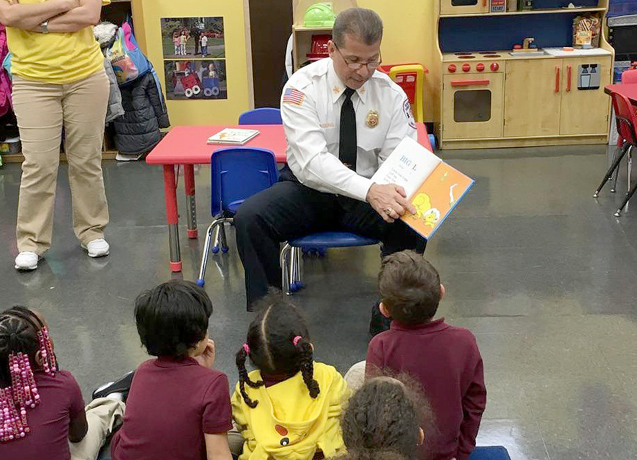 (above, l-r) Chief William R. Young Jr. of the Rahway Fire Department is shown on March 16, 2016 reading Dr. Seuss to the children of Ms. Jane's and Mrs. Virginia's Pre-Kindergarten class at The Rahway JFK Center.