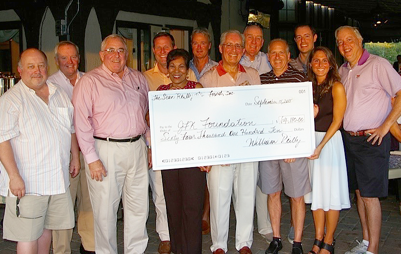 (above) The Sean Reilly TBI Fund Board of Directors proudly displays it's check for over $64,000 to The JFK Foundation
