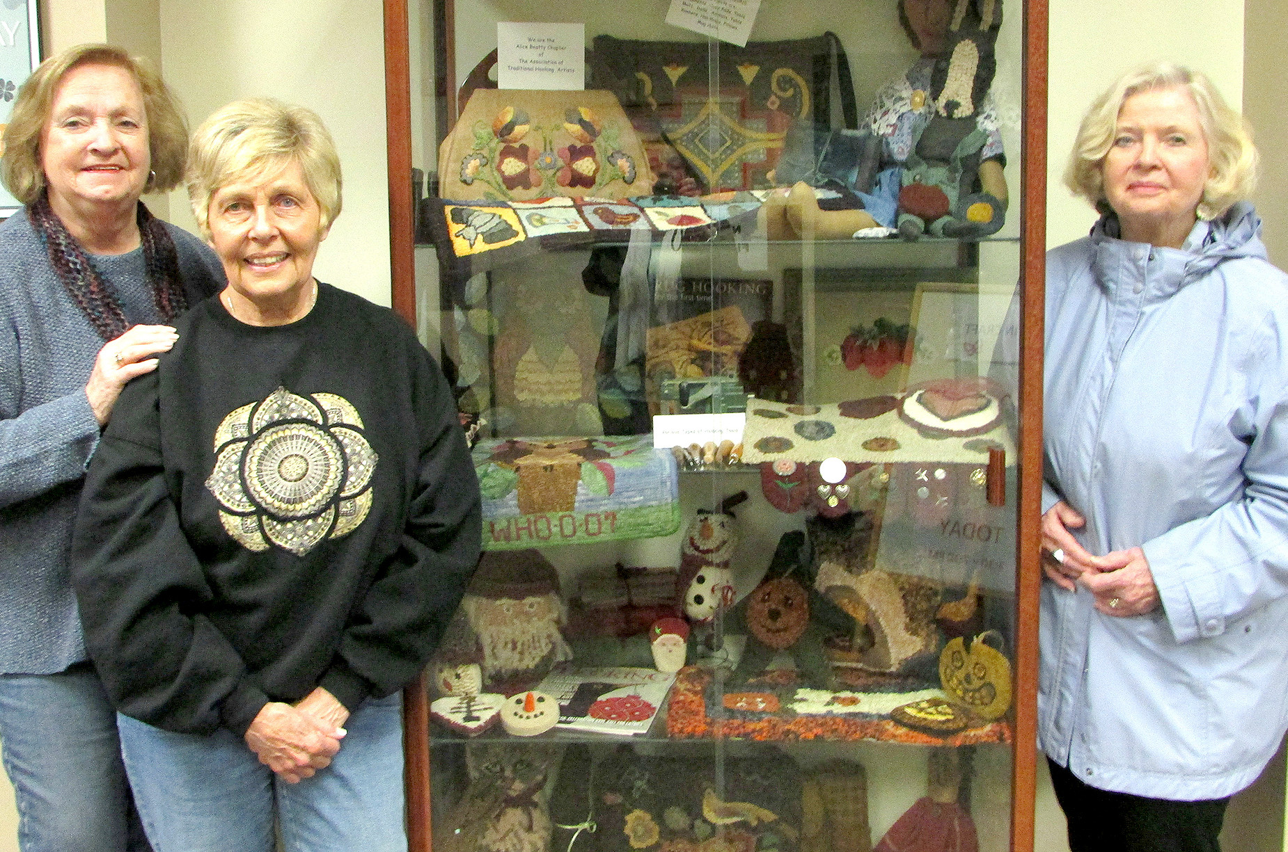 (above) The Alice Beatty Chapter of The Association of Traditional Hooking Artists members (left to right): Arline W.Bechtoldt- Apgar, Susan Johnson, and Phyllis Fittipaldi.