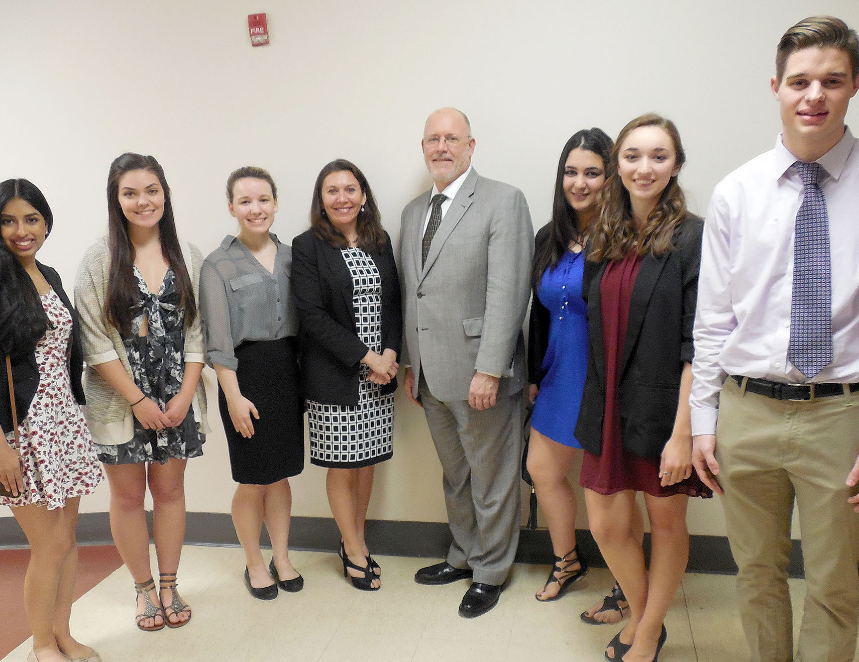 (above) Standing on either  side of guest speaker Amanda Seewald, fourth left, president of the Foreign Language Educators of New Jersey, and Brad Commerford, supervisor of World Languages at WHRHS, are students (l-r) Senior Anjali J. Patel of Warren Township; senior Olena Alexandra Hadlet of Millington; junior Arielle Ostry of Green Brook Township; junior Sonali Howe of Green Brook Township; senior Jenna Charko of Warren; and senior Lukas Ihringer of Gillette. Sonali Howe, was inducted into two language honor societies, Latin and Spanish.