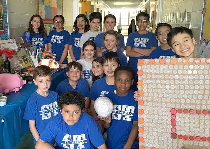 """(above) Mrs.Aronowitz and her 6th grade class at St. Theresa School in Kenilworth did a project called """" Garbage Art"""" with recycled materials. Sixth grade is currently studying Earth's Resources and were asked to create a piece of """"Garbage Art"""" with materials from the home. They used their resources and imagination and were very creative from a basketball board to a pineapple light."""