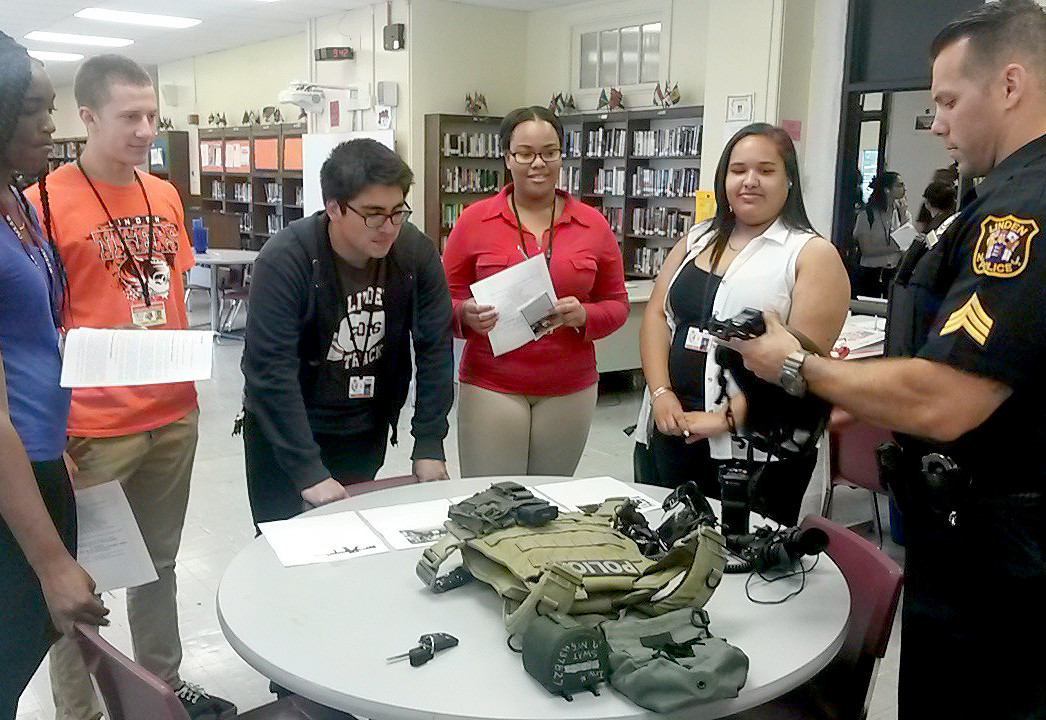 (above) On June 8, 2016, Linden High School held its annual Law Day festivities. Students were brought down during their various Social Studies classes to participate. These students had the opportunity to learn about the various law related career paths available to them. Students were able to talk to members of the Linden Police Department and SWAT, Union County Sheriff's Office, Union County Prosecutors Office, and the John H. Stamler Police Academy. During the event students and guests discussed the ins and outs of various jobs and how the guests saw their role in the legal system. A huge thank you to all of our guests and students for their enthusiastic participation.