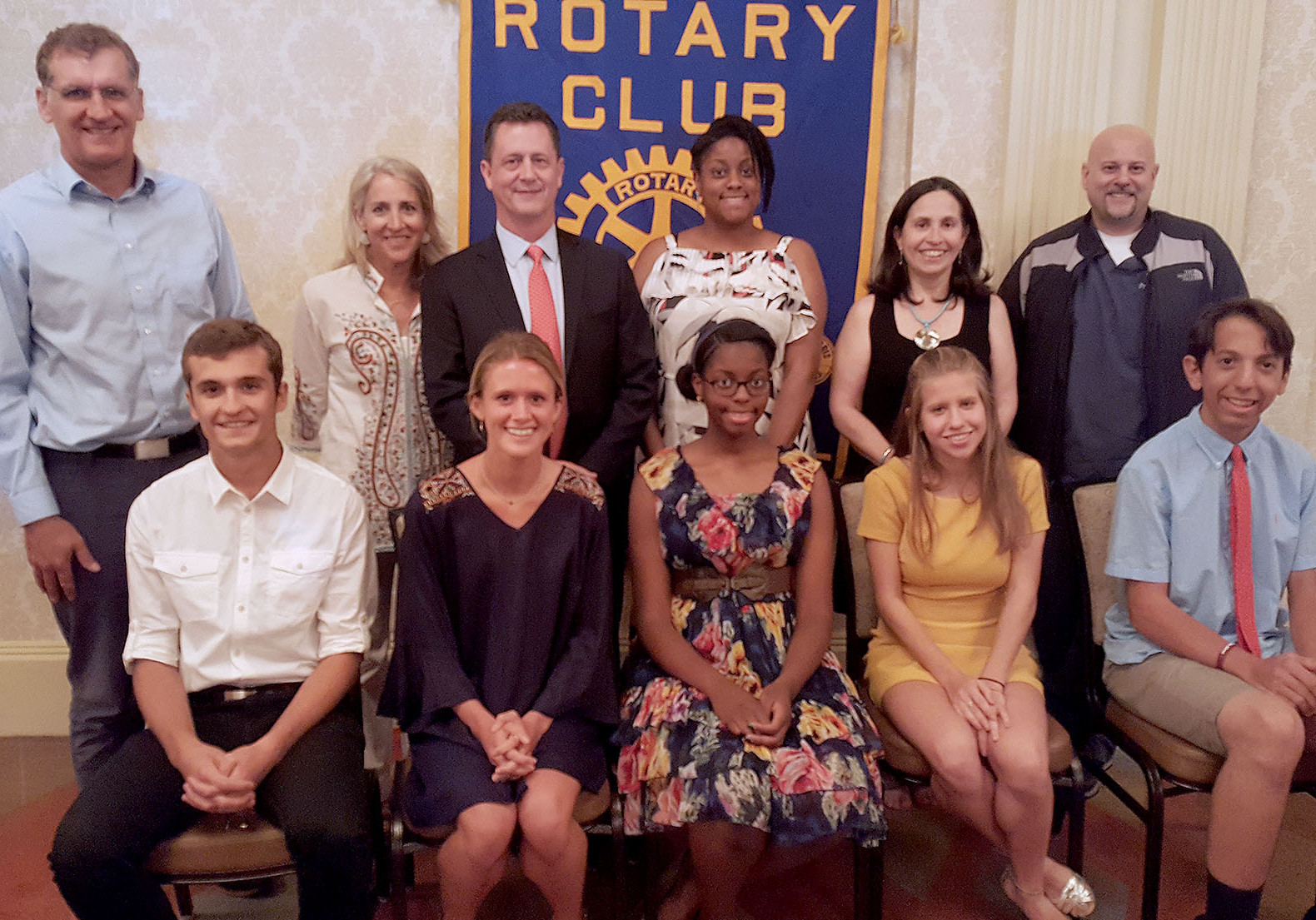(above l-r) Seated in front of their parents scholarship winners with their parents: Lorik Berisha, Samantha Hanley, Ife Campbell, Juliana Nociara,; and John Berardi.