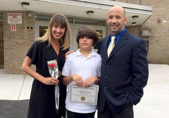 (above) Justice Lopez with his parents Laura and Ray.