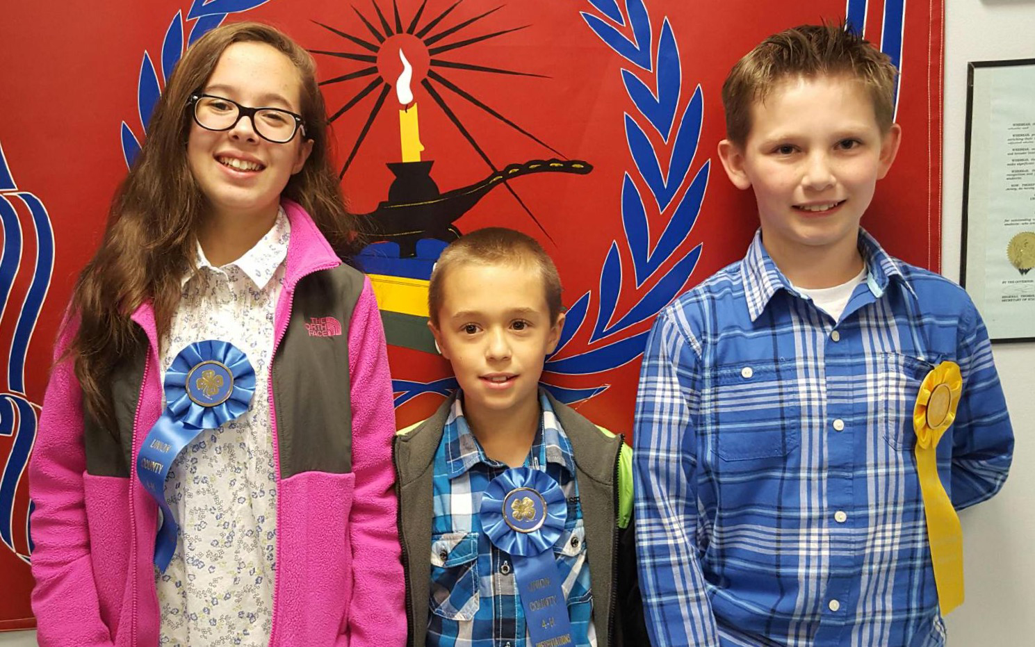 (above) Ariana Rodriguez, Diego Rodriguez, and Alex Pillar, all of of whom won awards for their presentations. Not pictured in the 4-H Club are Ashton and Ryan Armstead, Joscelin Busse, Erica Conde, and Francesca and Gianni Villani.