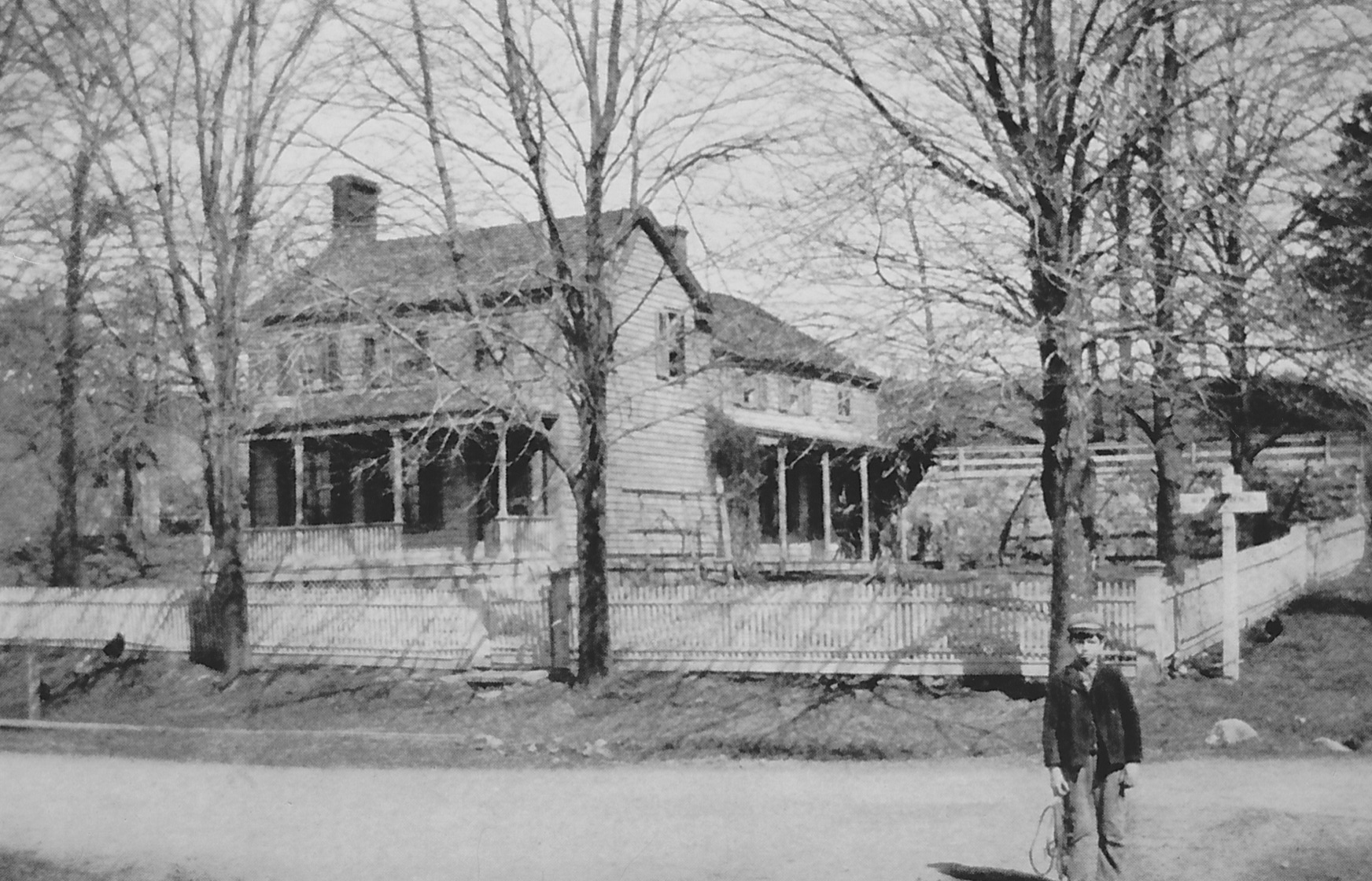 (above) A vintage photo of the Levi Cory house as it appeared in the early 1900s. Recently, the bow window was removed from the Levi Cory house and replaced with siding to restore it to its original appearance.