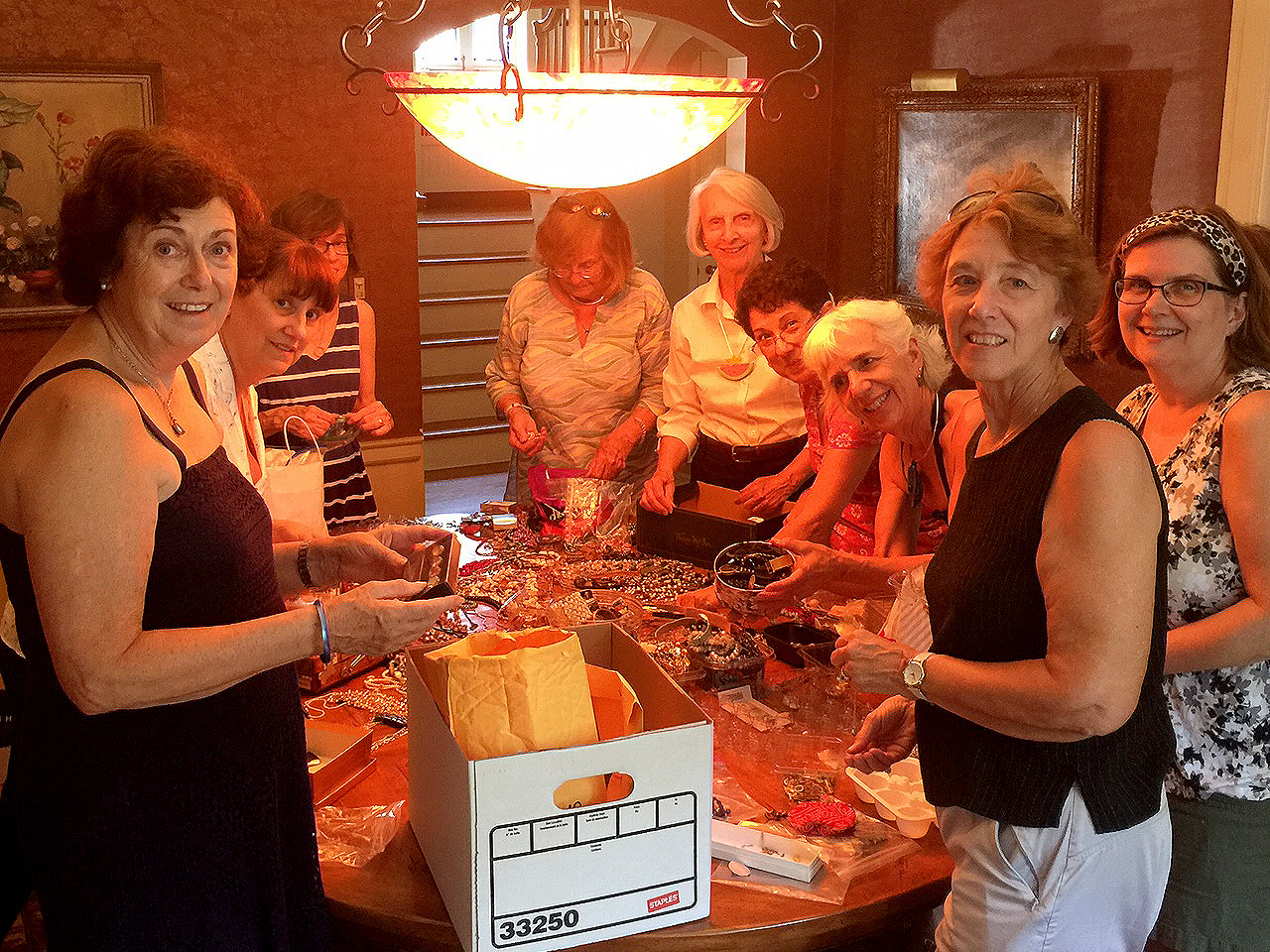 (above) Members of the Friends of the Summit Free Public Library sort through jewelry donations at the home of former Mayor Ellen Dickson for their upcoming sale. Sheila Bonnell (far right) and Ellen Dickson are Co-Chairs for the sale.