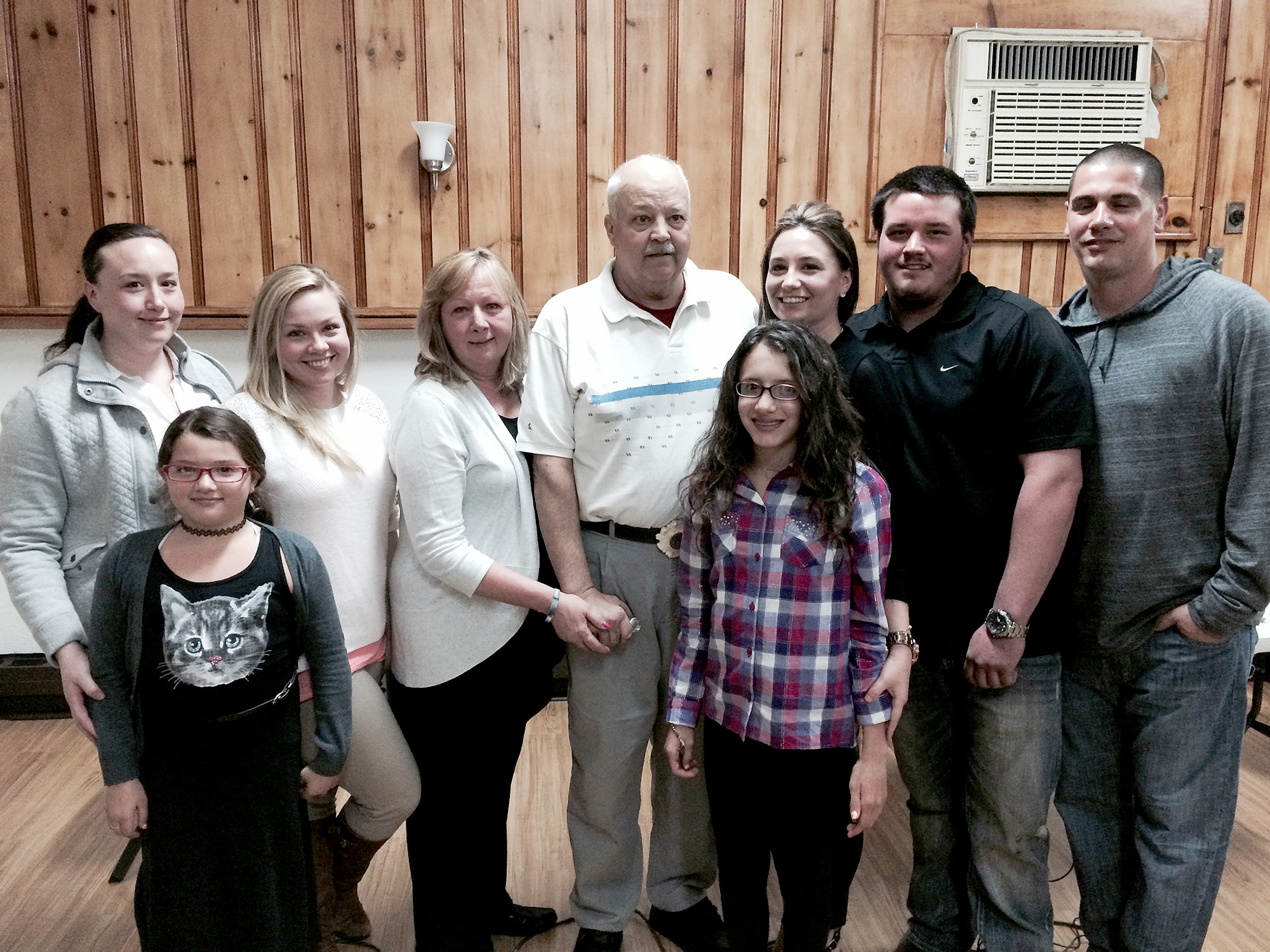 (above, back, l-r) Katelyn Sheehy (daughter), Dayna Sheehy (daughter), Linda Sheehy (wife), Jack Sheehy, Jaclyn Sheehy (daughter), John Sheehy III (son), Michael Wille (son-in-law). (front, l-r) Milani Wille and Alyssa Wille (granddaughters).