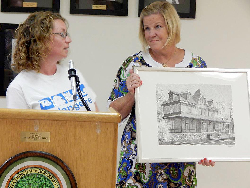 (above l-r) Volunteer of the Month Jennifer Coppock-Huegel and Mayor Mahr.