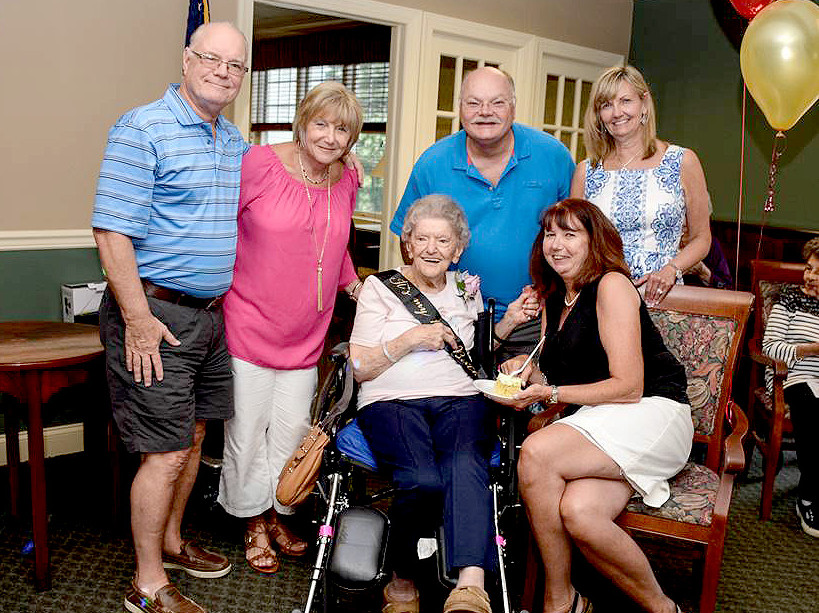 (above, center, l-r) Mrs. LaHoff makes a grand entrance into the party with family. (standing, l-r) Robert and Eva Miller, Michael Miller and Maureen Stivale, (seated, l-r) seated Mrs. LaHoff and Elaine Miller.