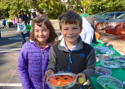 (above) Families with kids of all ages enjoy the annual Jefferson Fall Festival, including the cake walk, face painting, pumpkin decorating, and more. Photos by Jen Hinger