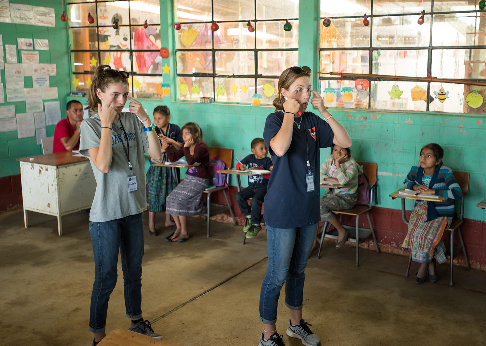(above l-r) Isabelle Kenny and Christina (Nina) Maurizi, both of Summit, take the reins of the classroom during their service trip to Guatemala this summer. Photo: Adam Richins Photography.