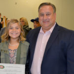 (above) Reese Passuth, fifth grader at the Frank K. Hehnly School and winner of the Columbus Day Essay contest for her school stands with Clark Mayor Sal Bonaccorso. The contest was sponsored by the Clark UNICO.