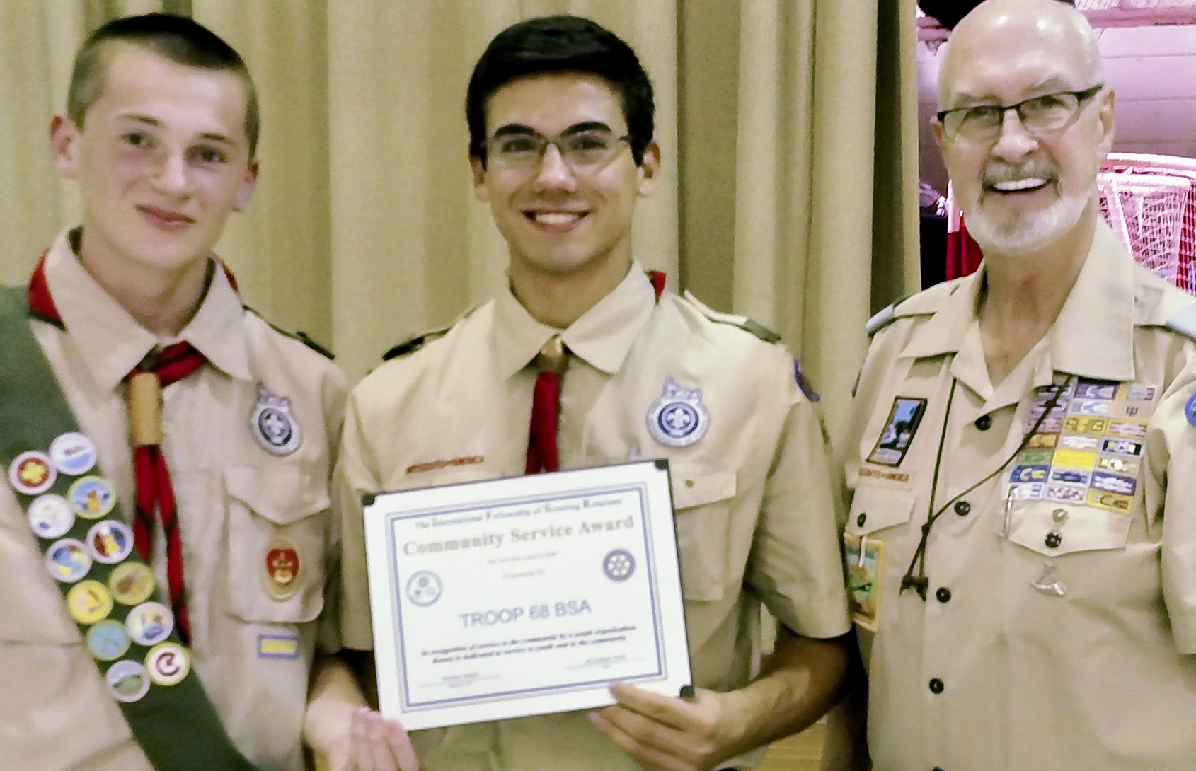 (above) The Rotary Community Service Award was presented by Dr. Hal Daume, Rotary Club representative and Scouting Commissioner, to Senior Patrol Leader Doug Ladzinski and Assistant Senior Patrol Leader for Service Kyle Engemann.